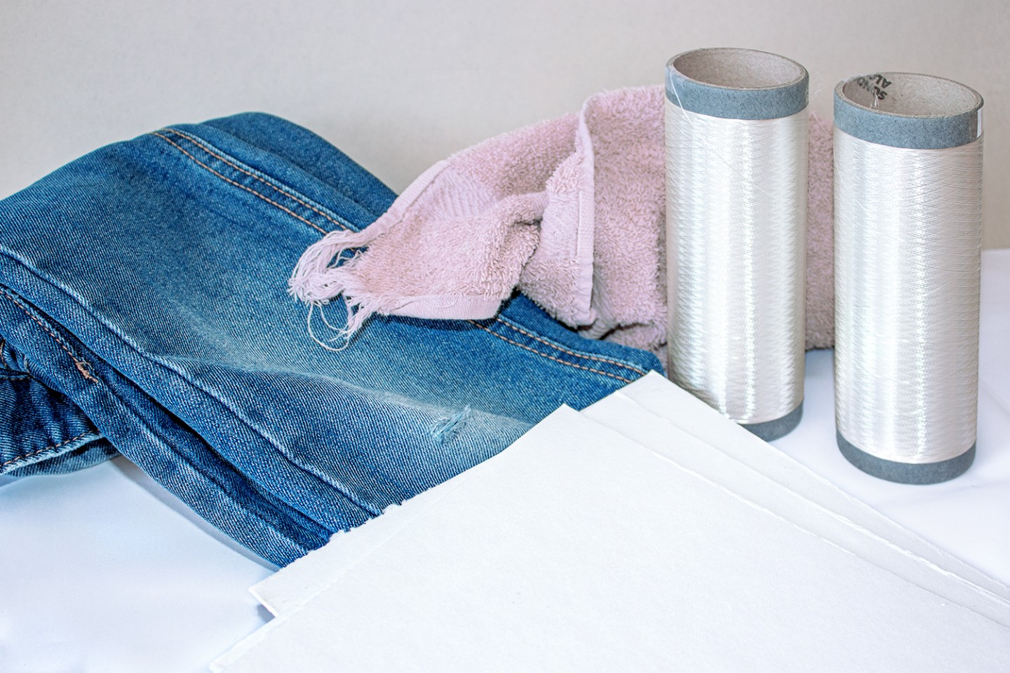 Wound onto a spool, the viscose filament yarn was spun from recycled cotton provided in form of cellulose sheets. Researchers at the Fraunhofer IAP have found a way to turn cotton clothes such as jeans into new high-quality garments rather than lowly cleaning rags.