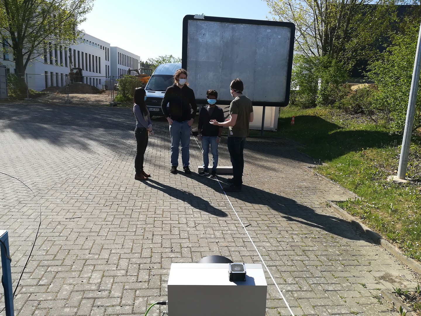 Testing the radar-based detection of the vital parameters of a group of people as they move naturally in an environment at Fraunhofer FHR (from left to right: Siying Wang, Alexander Bauer, Manjunath Thindlu Rudrappa and Reinhold Herschel).